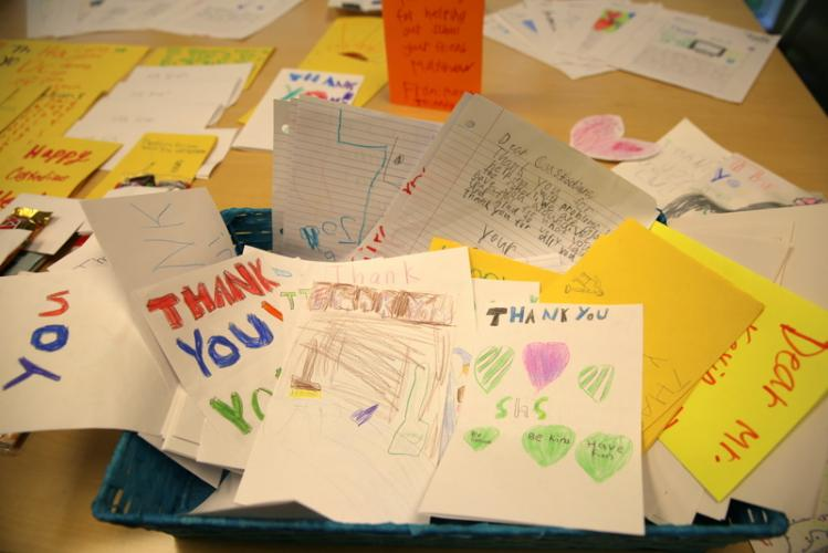 In honor of National Custodial Worker's Recognition Day on October 2 Sandy Hook School students wrote letters to the school's four custodians, Rick Thorne, Andy Spencer, Kevin Anzellotti, and Gene Schaniel. (Bee Photo, Hallabeck)