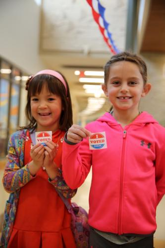 "Sandy Hook School first graders Morgan Carr, left, and Delia Stango hold their ""I Voted"" stickers.  (Bee Photo, Hallabeck)"