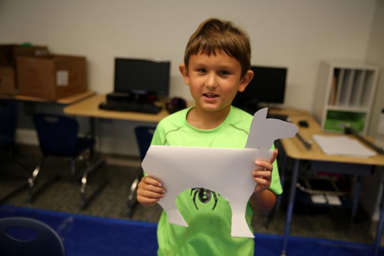Coleman Joshpe, 6, holds a paper unicorn she was working on in the SMART Camp animals in art through time class. (Bee Photo, Hallabeck)