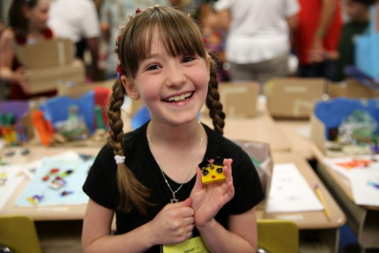 SMART camper Adina Koldewyn holds one of her creations from the Fused Glass class. (Bee Photo, Hallabeck)