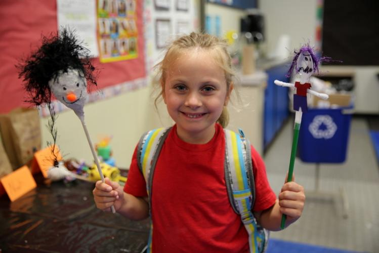 SMART camper Hadley Camp holds two of her Paper Mache class creations.  (Bee Photo, Hallabeck)