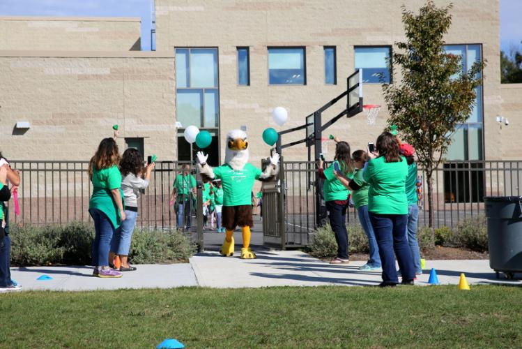 The Sandy Hook School eagle mascot exits the school to begin the 1st Annual Walk-A-Thon on October 13. (Bee Photo, Hallabeck)