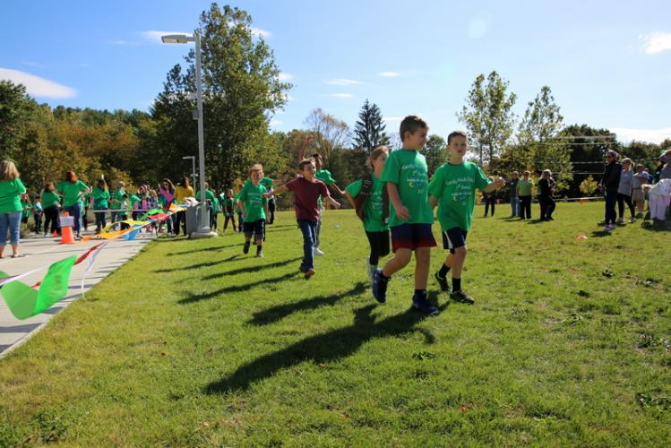 Sandy Hook School third graders Thomas Charles, walking front left, and Dante Aimes, front right, lead a group of students in one lap of the Walk-A-Thon on October 13. (Bee Photo, Hallabeck)