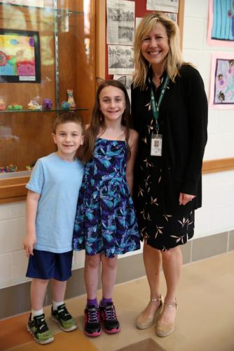 Sandy Hook Elementary School first grader Vincent Yanni and his sister, fourth grader Jianvanna Yanni, stand with art teacher Kim Hossler at the school's art show on May 24. (Bee Photo, Hallabeck)
