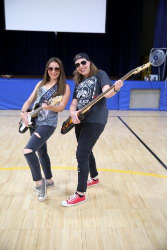 Middle Gate Elementary School Language Arts Consultant Lina Silveira and Math/Science Specialist Jill Bracksieck rock out between two assemblies on June 21 designed to get students excited for C.H. Booth Library's Summer Reading Program, for…