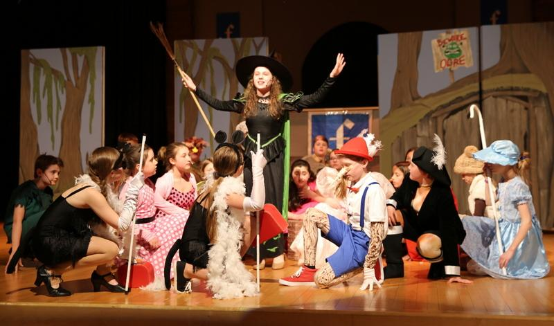 Madeline Roe, center, sings as the Wicked Witch during a dress rehearsal for Reed's production of Shrek, Jr. (Bee Photo, Hallabeck)