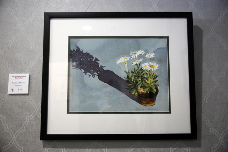"""Artist Michelle Williams Rosenthal's """"Sunshire Daisies"""" was on display at The AIR Fine Art Gallery at Avance Day Spa on Church Hill Road for the """"Spring is in the AIR"""" show. (Bee Photo, Hallabeck)"""