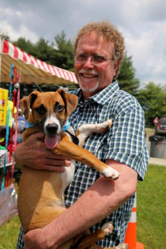 Andy Spencer holds puppy Action Jackson near the start of the Strutt Your Mutt event.  (Bee Photo, Hallabeck)