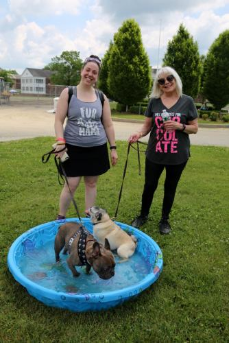 Kelly Smith, left, and mother, Darlene Smith, stand by as their dogs Waylon, left, and Bug, chill in a kiddie pool at the June 2 Strutt Your Mutt event. (Bee Photo, Hallabeck)