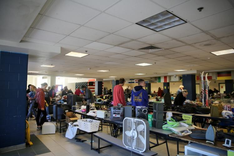 People mill about the NHS cafeteria on October 21 during the NHS Marching Band & Guard's 100+ Family Tag Sale. (Bee Photo, Hallabeck)