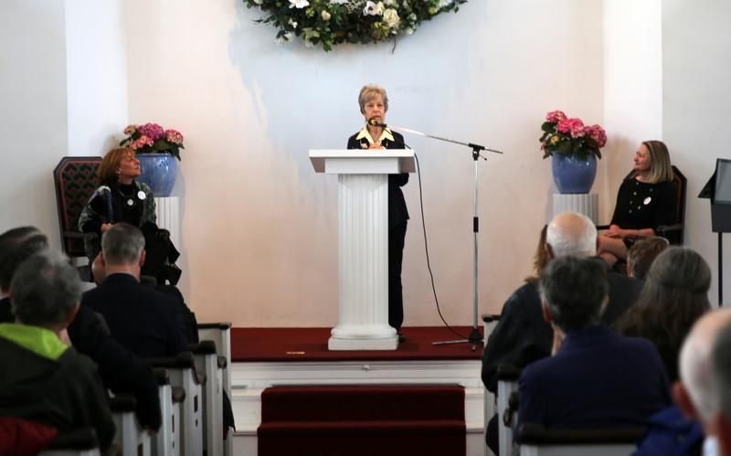 """Newtown resident Mary Gaudet-Wilson reads the poem """"Bees"""" by Norman Rowland Gale during the third annual Risk A Verse, a National Poetry Month event hosted by Newtown Cultural Arts Commission. (Bee Photo, Hallabeck)"""