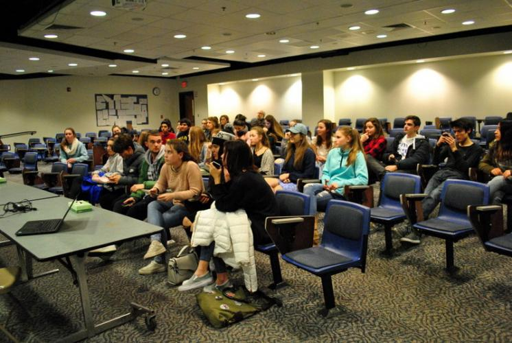 Newtown High School students and Spain delegation students sit together in the NHS Lecture Hall on March 20 before completing surveys about the visit and taping video messages. (Bee Photo, Hallabeck)