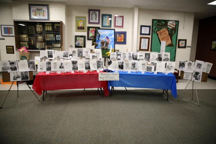 Student drawn portraits were on display next to the submitted pictures of veterans at NMS. (Bee Photo, Hallabeck)