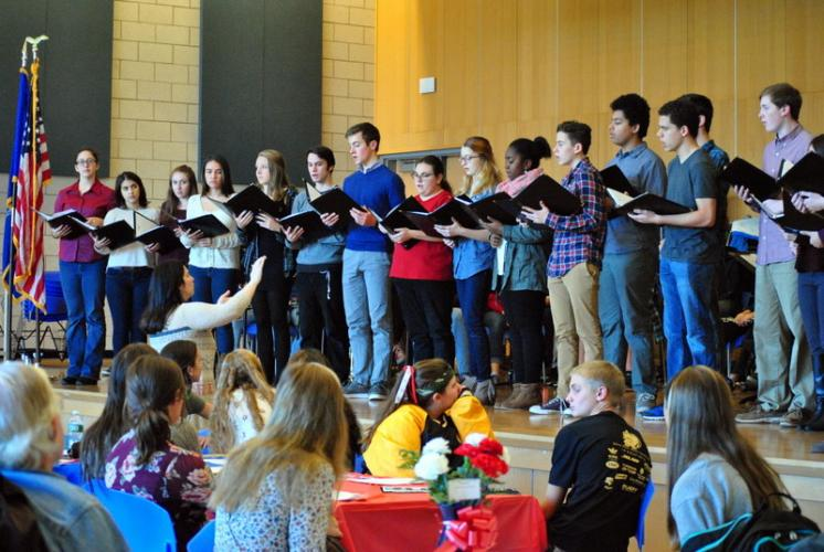 """NHS Singers performed """"America the Beautiful"""" under the direction of Jane Matson. (Bee Photo, Hallabeck)"""