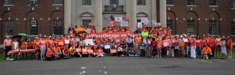 Attendees at the 3rd Annual Newtown #WearOrange March & Rally for National Gun Violence Prevention Day on June 2 gather on the front steps of Shelton House. By the time the group marched from Fairfield Hills to Newtown Middle School, and…