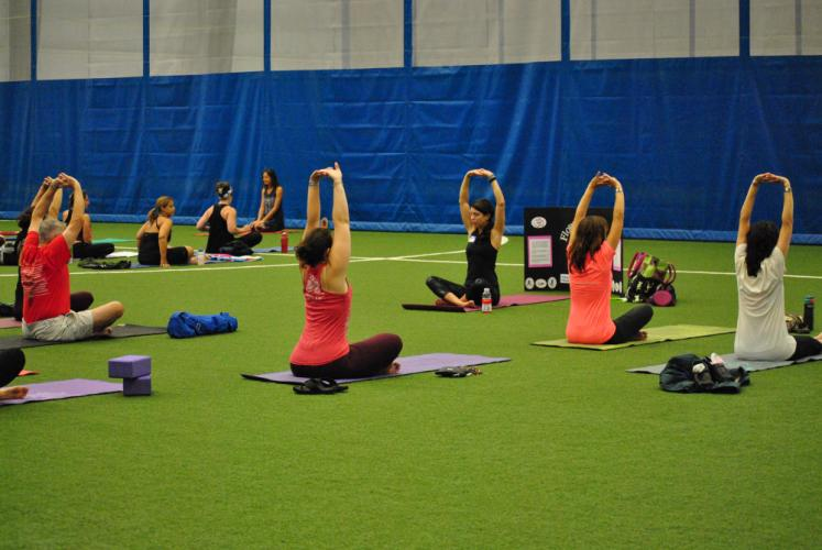 Instructor Amie Meleshkewich led one group of 2015 Newtown Yoga Festival participants on Saturday, August 22, at NYA Sports & Fitness Center.
