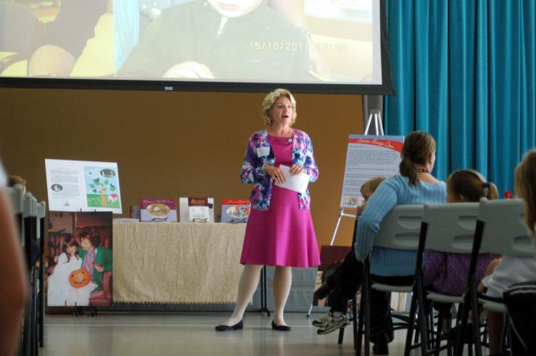 Glenna C. Orr, director of Kind Kids, Inc, a nonprofit organization, spoke to St Rose of Lima School students on Tuesday, September 24, about her organization and her published books.