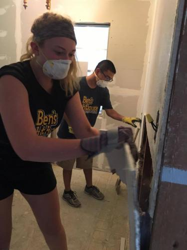 Erin Mitchell and Evan Song remove moldy drywall on a flooded home in Denham Springs, La.  (Rebecca Cosgrove photo)