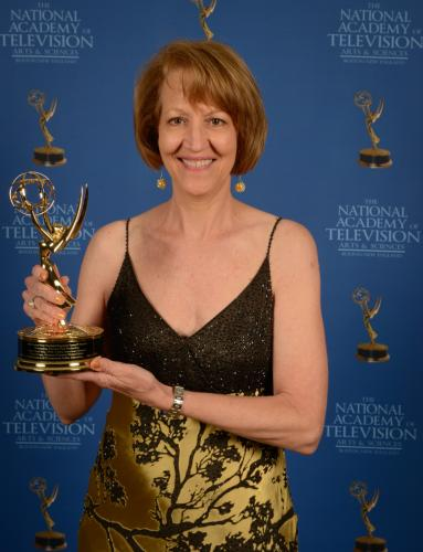 Newtown native Karyl K. Evans holds up one of the six Emmy Awards she has earned (so far) in her career as a filmmaker. The newest film by Ms Evans, The Life and Gardens of Beatrix Farrand, will premiere in New Haven on June 5 as part of the third…