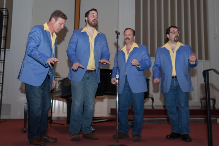 The acapella Take Four Quartet, featuring Victor Lembo, Jordan Kugler, Scott Poarch, and Chris Andrade, were among the professional acts who mixed with musicians and other young amateur performers during the most recent Families United in Newtown …