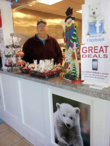 Owner John Martin stands behind the counter at his Frosty Bear Ice Cream Shop, located on Route 25 about a mile south of the Newtown-Monroe border in Monroe, adjacent to Creative Music. Mr Martin is not letting winter weather keep him from serving…