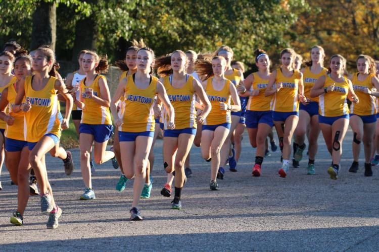 Girls' cross country team members take off at the start of the final race of the regular season. (Brandy Jacobs photo)