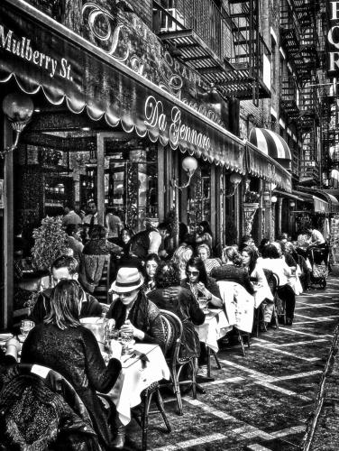 Diners fill an outdoor seating area in this streetscape image by Bill Glass, who will have a one-artist exhibition at Booth Library in November.  (photo courtesy Bill Glass)