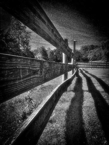 An exhibition of 30 photographs by Newtown resident Bill Glass, including this dramatic black and white work along a fenceline, will be included in a one-artist exhibition being presented in November at C.H. Booth Library.  (photo courtesy Bill Glass)