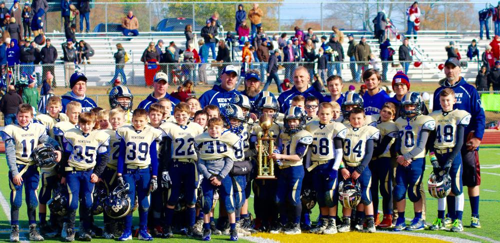 The fourth grade football team was runner-up in the Shoreline Conference and celebrated its trip to the championship round. (Jenn Foss photo)