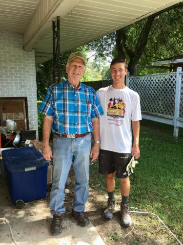 Louisiana homeowner Oscar Welch, left, stands with Grant Larson, one of 12 young adults who traveled to the Baton Rouge area in July to help homeowners continue rebuilding their homes a year after devastating floods across the region. (Rebecca…
