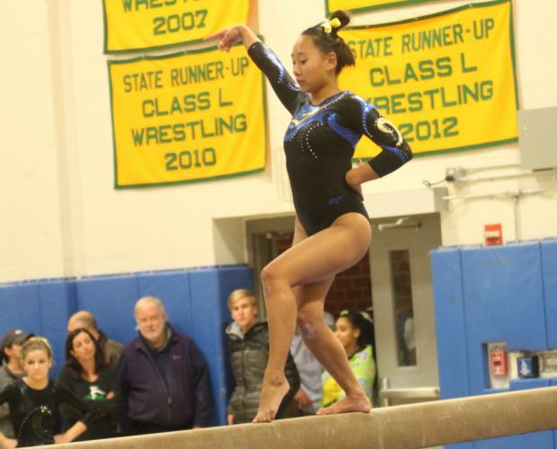 Emma Delia competes on the balance beam. (Chris Jannott photo)