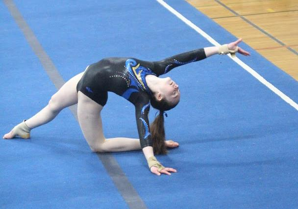Ally Kenny placed third on the floor during Newtown's visit to Law High on January 22. (Chris Jannott photo)