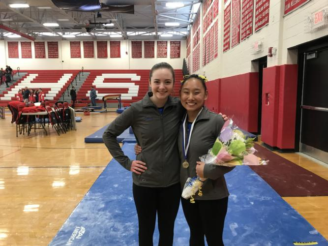 Ally Kenny, left, and Emma Delia represented Newtown in the State Open gymnastics championships.