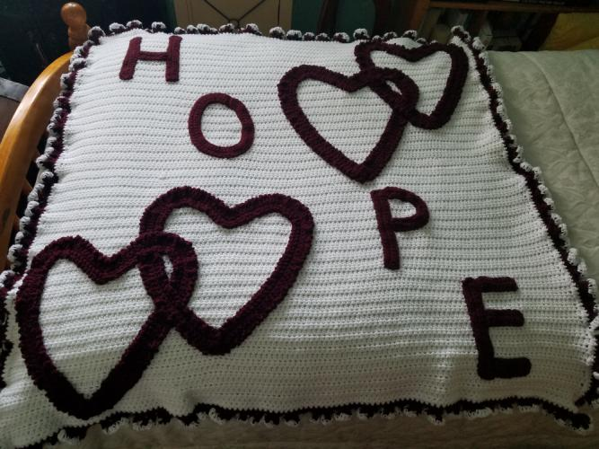 This white and maroon lap quilt will be raffled during the January Hearts of Hope-Newtown painting party.  (photo courtesy Pattie Ptak)