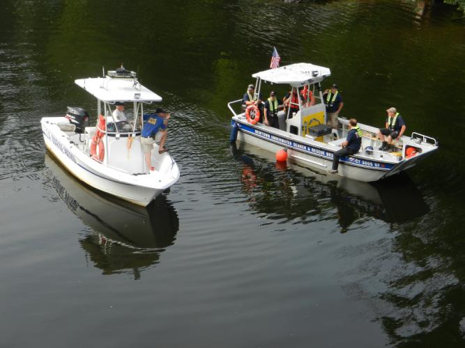 At Lake Zoar on September 1, police worked with members of Newtown Underwater Search And Rescue (NUSAR) and the Lake Zoar Authority Marine Patrol in a search for clues in the disappearance of Robert Hoagland, 50, of Glen Road, who went missing in…