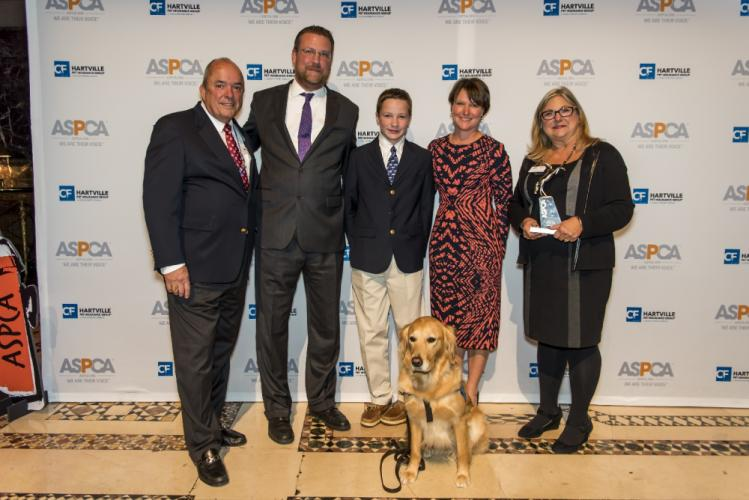 Pictured is LCC President Tim Hetzner, Matt Hubbard, Freddy Hubbard, Jenny Hubbard, Ruthie's handler Dona Martin, and service dog Ruthie. (photo courtesy of Jenny Hubbard)