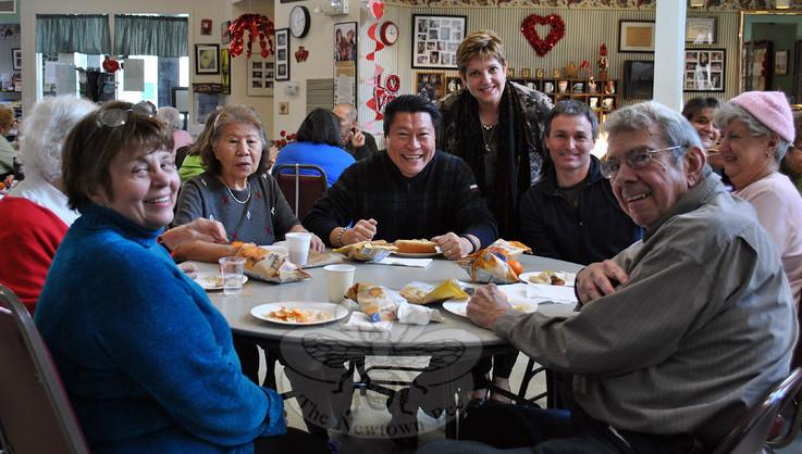 State Senator Tony Hwang (seated, center) is joined by Newtown Senior Center Director Marilyn Place (standing) and members of the center during a special event in January 2015. Mr Hwang will return to the Riverside Road facility on Friday, December…