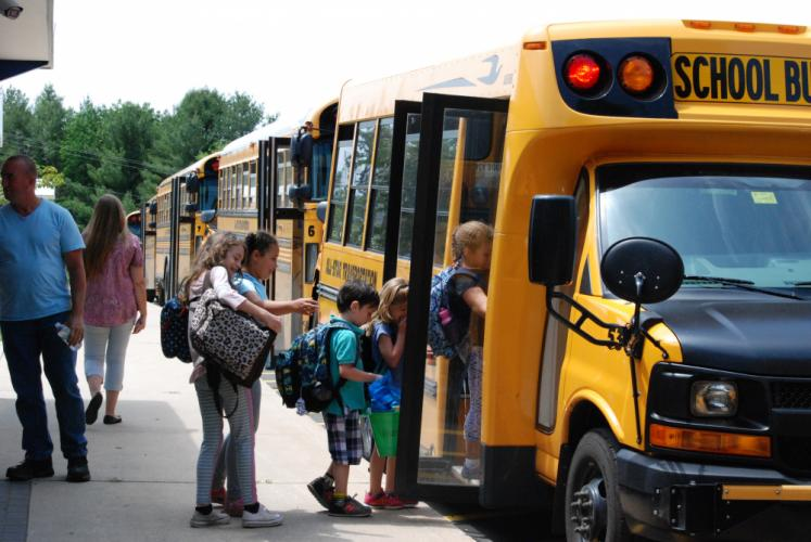 Middle Gate students climb onto school buses for the final time of the 2016-17 school year, Thursday afternoon, June 15.  (Bee Photo,Preszler)