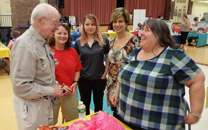 During his visit to the September 16 Newtown Public Health & Safety Fair at Reed Intermediate School, Dr. Thomas Draper greets Kevin's Community Center Clinic Director Mary Nielson while Newtown Health District Director Donna Culbert, Access Health…
