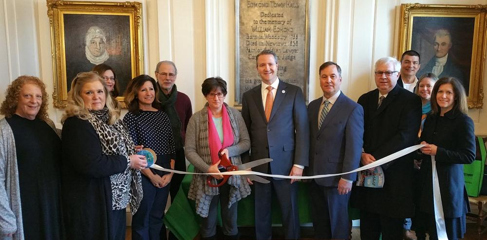 Gentle Healing Bodywork owner Stephanie Besson, LMT, holds the scissors as she is joined by First Selectman Dan Rosenthal and members of the Newtown Chamber of Commerce and the Newtown Economic Development Commission during a recent ceremonial…