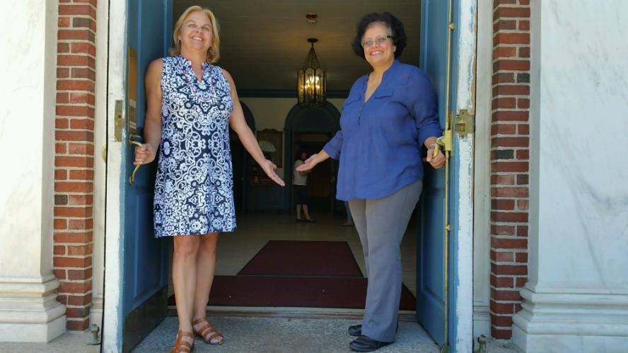 Newtown Chamber of Commerce Director of Business Development Helen Brickfield, left, and Edmond Town Hall Facility Manager Sheila Torres welcome visitors to the stately former municipal facility on Main Street. One of the chamber's newest members,…