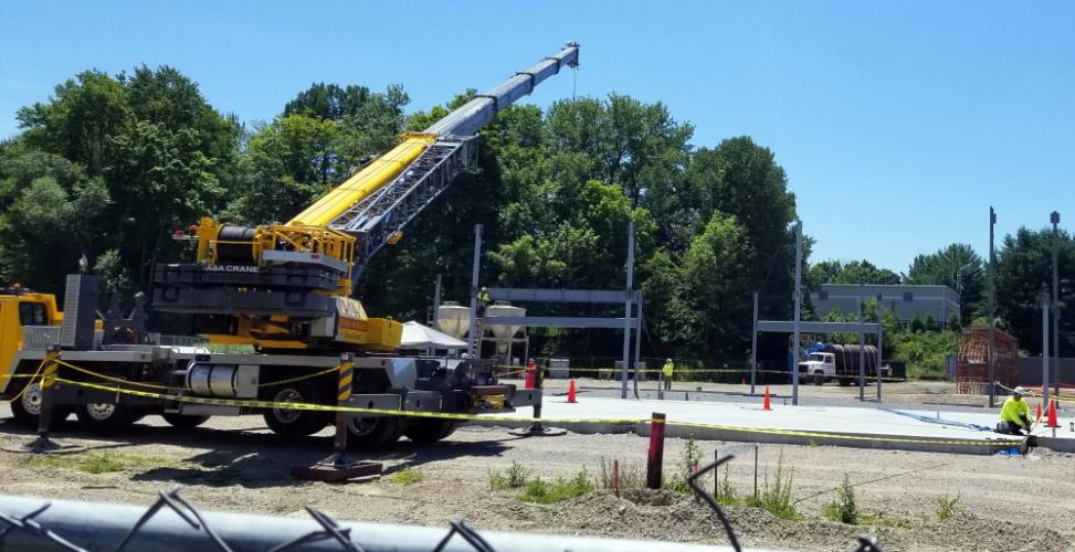 Steel workers, sometimes known as 'fasteners,' work to attach crossbeams to the steel supports on the site of the new community and senior center Monday, July 9, at Fairfield Hills.  (Bee Photo, Voket)