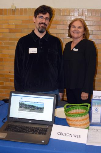 Dan Cruson, Jr, of Cruson Web shows off the newly redesigned Newtown Chamber of Commerce website. He is pictured with Helen Brickfield, who serves as the chamber's business development director.   (Bee Photo, Voket)