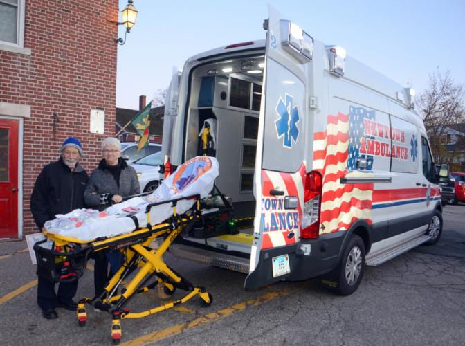 Dr Robert Grossman and Joan Crick check out the newest rig to be placed in service by the Newtown Volunteer Ambulance Corps, which was represented at the 14th Annual Destination Newtown business showcase.   (Bee Photo, Voket)