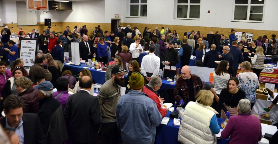 Between 700 and 800 attendees and vendors mixed and enjoyed networking and pizza during the 14th Annual Destination Newtown business showcase that was held November 16 at Edmond Town Hall.   (Bee Photo, Voket)