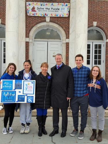 On World Autism Awareness Day, April 2, Newtown High School Honors Society volunteers for the local grassroots autism support organization FUN - Families United in Newtown - gathered with its founder and First Selectman Dan Rosenthal in front of…