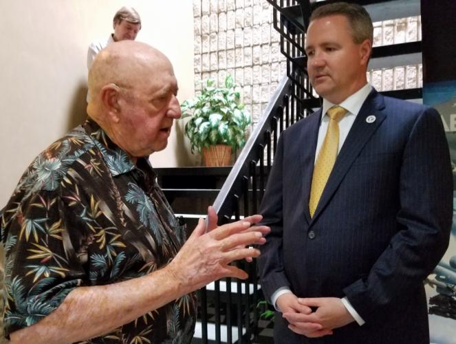 First Selectman Dan Rosenthal, right, chats with Forecast International CEO Ed Nebinger before the local company founder received a Patriot Award from ESGR - Employer Support of the Guard and Reserve - for his support of the many military personnel…