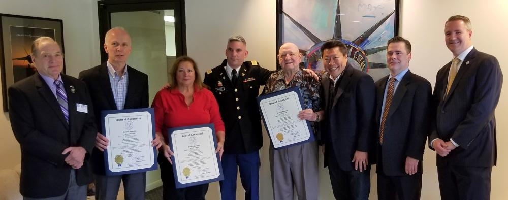 Ted Graziani, chairman of the Connecticut chapter of Employer Support of the Guard and Reserve (ESGR) presented his organization's Patriot Award to the CEO and two staff members at Newtown-based Forecast International on June 4. He is pictured…