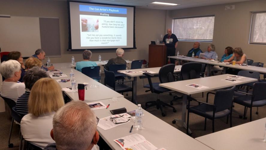 "AARP ""Fraud Watch"" volunteer Henry Stair leads a May 2 workshop sponsored by Newtown Savings Bank that revealed myriad ways scammers too often succeed in ripping off trusting seniors.  (Bee Photo, Voket)"