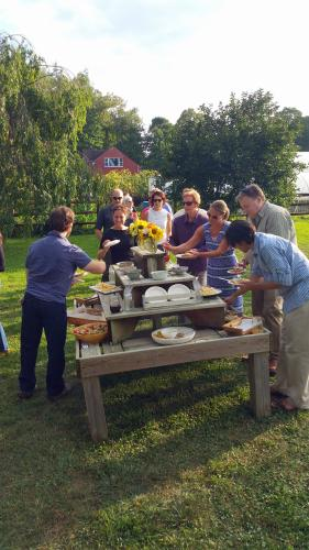 Farm dinner guests flock to the app table.